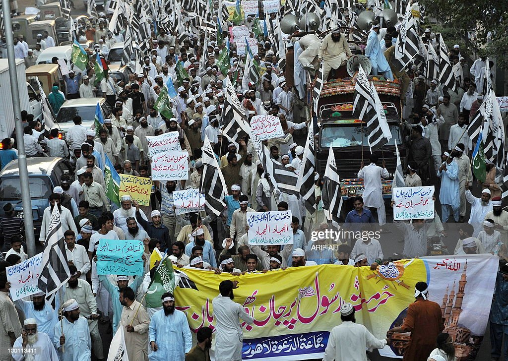 Activists of Pakistani coalition of Islamic groups, including Jamaat-ud Dawa, march during a protest in Lahore on May 21, 2010, against the published caricatures of Prophet Mohammed on Facebook. Pakistani protesters shouted 'Death to Facebook', 'Death to America' and burnt US flags, venting growing anger over 'sacrilegious' caricatures of the Prophet Mohammed on the Internet. A Facebook user organised an 'Everyone Draw Mohammed Day' competition to promote 'freedom of expression', inspired by an American woman cartoonist, but sparked a major backlash in the conservative Muslim country of 170 million. Islam strictly prohibits the depiction of any prophet as blasphemous and the row has sparked comparison with protests across the Muslim world over the publication of satirical cartoons of Mohammed in European newspapers in 2006.