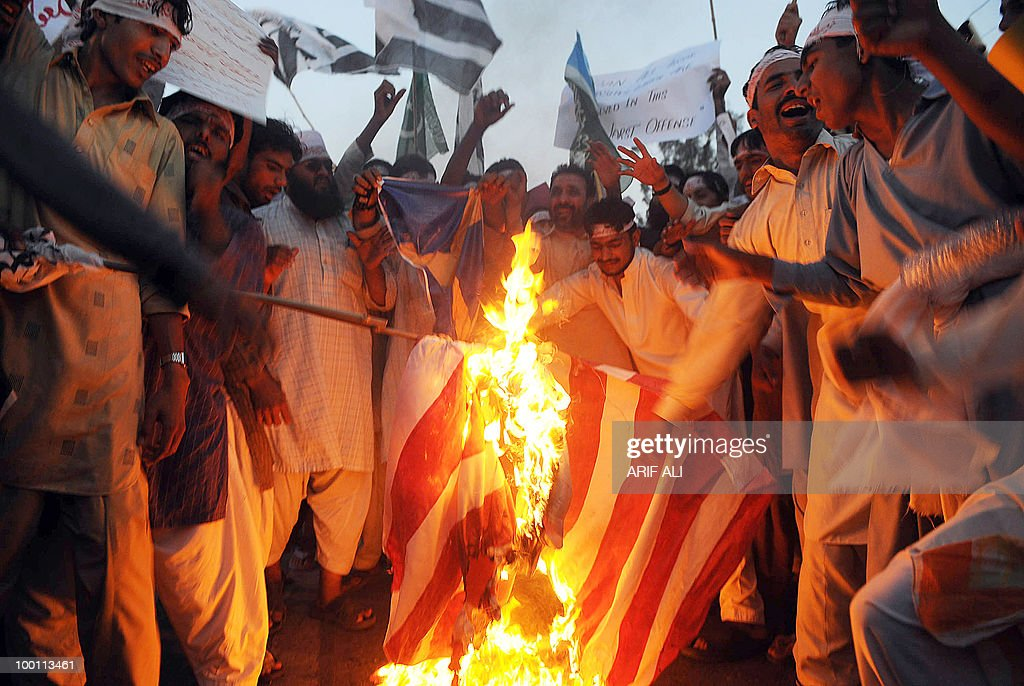Activists of Pakistani coalition of Islamic groups, including Jamaat-ud Dawa, torch a US national flag during a protest in Lahore on May 21, 2010, against the published caricatures of Prophet Mohammed on Facebook. Pakistani protesters shouted 'Death to Facebook', 'Death to America' and burnt US flags, venting growing anger over 'sacrilegious' caricatures of the Prophet Mohammed on the Internet. A Facebook user organised an 'Everyone Draw Mohammed Day' competition to promote 'freedom of expression', inspired by an American woman cartoonist, but sparked a major backlash in the conservative Muslim country of 170 million. Islam strictly prohibits the depiction of any prophet as blasphemous and the row has sparked comparison with protests across the Muslim world over the publication of satirical cartoons of Mohammed in European newspapers in 2006.