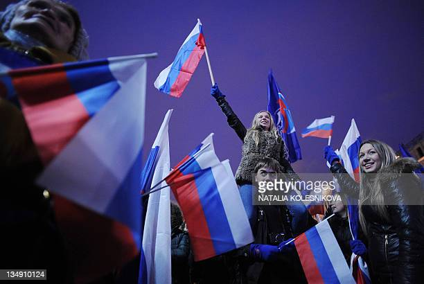Activists of proKremlin youth groups 'Moldaya gvardiya' and 'Nashi' attend a rally as they celebrate the victory of United Russia party in the...