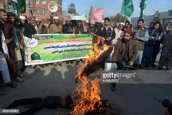 Activists of Rah e Haq Party burn effigies representing Iran and the United States during a protest in Peshawar on January 5 in the support of Saudi...