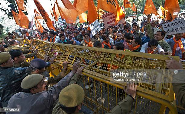 Activists of right wing Hindu Rashtrawadi Sena activists push a police barricade as they shout slogans demanding the construction of the Ram Temple...