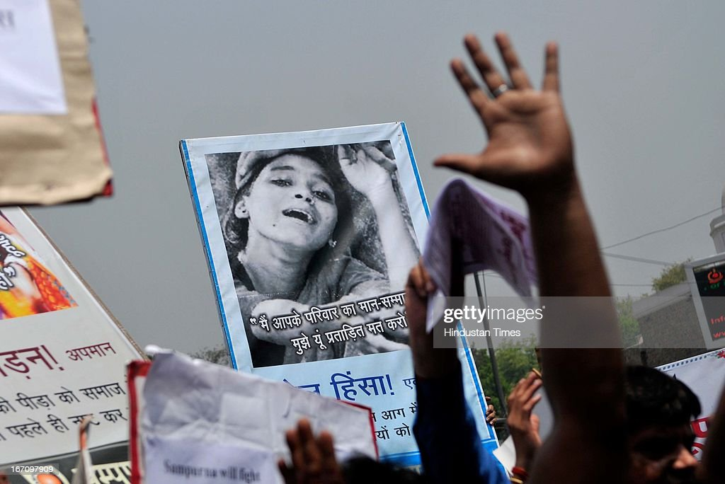 Activists of several groups holding placards during a protest outside Delhi Police Head Quarter demanding resignation of police commissioner Neeraj Kumar after a brutal rape of 5 year old girl and alleged police insensitivity in dealing with it on April 20, 2013 in New Delhi, India. A five year girl went missing on April 15 and was found on April 17 in same building where she lives with her parents. She was found in serious condition after being brutally raped and tortured with slashed neck and bite marks on her body. The man who lives in that room was arrested today in Bihar state.