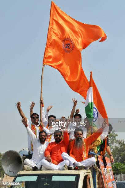 Activists of Shiv Sena shout slogans as they march towards the IndiaPakistan Wagah border during a protest march against the killing of Indian...