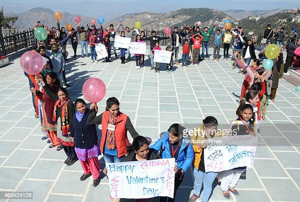 Activists of students unions DYFI SFI AIDWA celebrating Valentine day at Ridge on February 14 2015 in Shimla India Valentine's Day also known as...