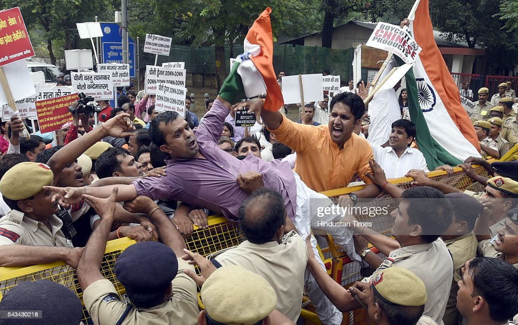 Activists of Swadeshi Jagaran Manch, a Hindu right wing organisation promoting indigenous products, shout slogans during a protest at China embassy on June 28, 2016 in New Delhi, India. The protestors accused China of blocking India's entry into the Nuclear Suppliers Group.