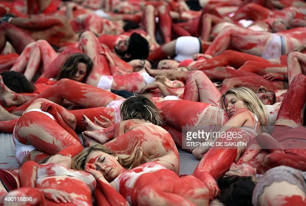 Activists of the animal liberation movement 269life lie on the Place du Palais Royal covered in red paint to represent blood as they stage an open...