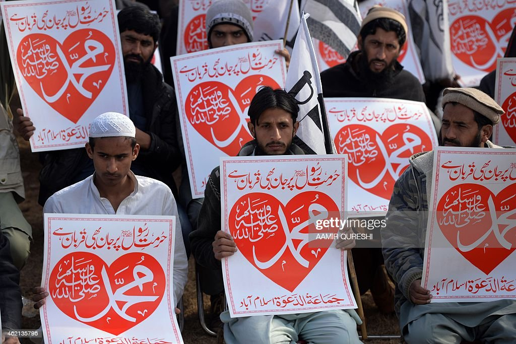 Activists of the banned Pakistan's charity organisation Jamaat-ud-Dawa (JuD) hold placards that read '<a gi-track='captionPersonalityLinkClicked' href=/galleries/search?phrase=Muhammad&family=editorial&specificpeople=3955327 ng-click='$event.stopPropagation()'>Muhammad</a>' during a protest against the printing of satirical sketches of the Prophet <a gi-track='captionPersonalityLinkClicked' href=/galleries/search?phrase=Muhammad&family=editorial&specificpeople=3955327 ng-click='$event.stopPropagation()'>Muhammad</a> by French magazine Charlie Hebdo in Islamabad on January 25, 2015. Tens of thousands across Afghanistan, Pakistan and Muslim-majority Indian Kashmir took to the streets on January 23 for southern Asia's biggest protests yet against satirical magazine Charlie Hebdo's cartoon portrayal of the Prophet Mohammed. AFP PHOTO/ Aamir QURESHI