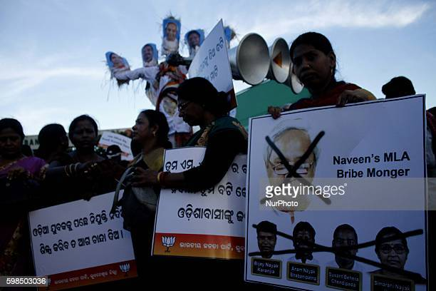 Activists of the Bharatiya Janata Party burnt the effigy of eastern Indian state Odishas chief minister Naveen Patnaik and his four corrupted MLAs...
