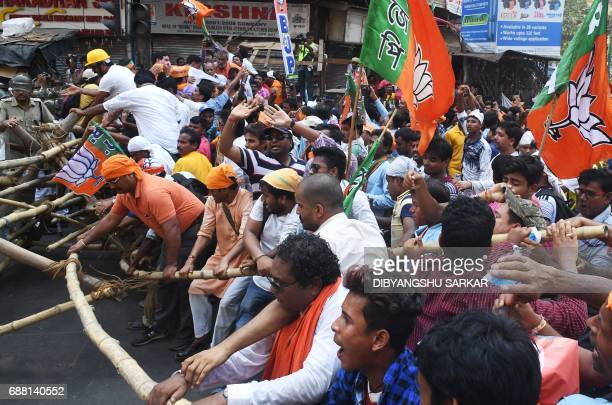 Activists of the Bhartiya Janata Party clash with Indian police next to the state police headquarters in Kolkata on May 25 2017 The activists...