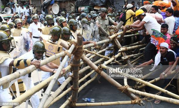 TOPSHOT Activists of the Bhartiya Janata Party clash with Indian police next to the state police headquarters in Kolkata on May 25 2017 The activists...