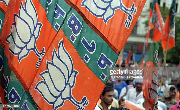 Activists of the Bhartiya Janata Party shout slogans as they march through the streets of Kolkata on June 18 2015 The rally followed by a meeting and...