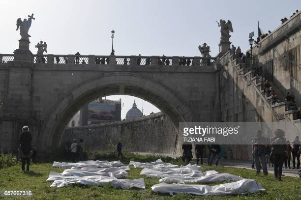 Activists of the civil society organizations take part in a symbolic protest against the EU's migration policy and to call for a more human and...