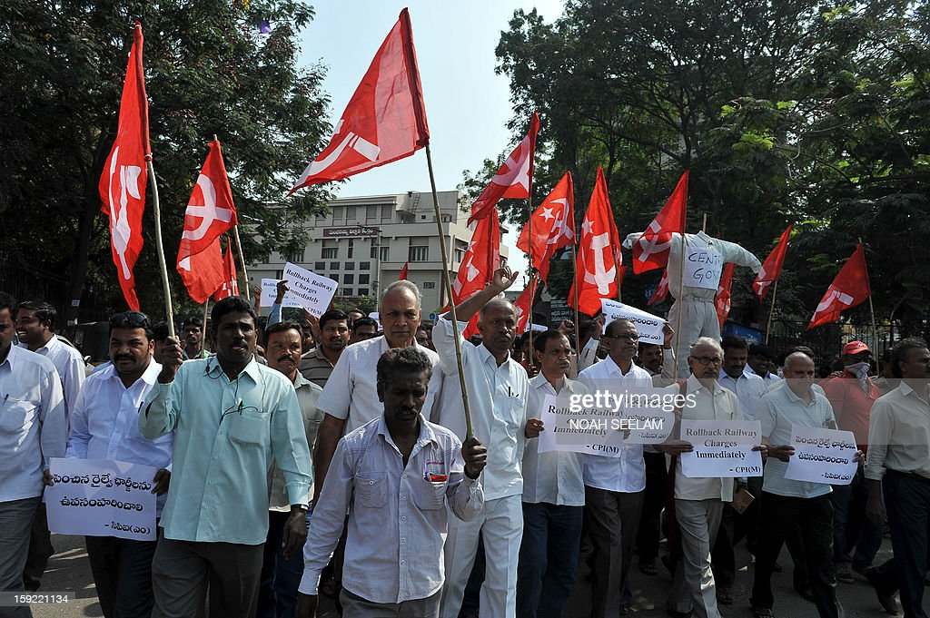 Activists of the Communist Party of India-Marxists(CPI-M) carry an effigy representing the United Progressive Alliance(UPA) during their protest against the rail fare hike, in Hyderabad on January 10, 2013. Union railways minister Pawan Kumar Bansal announced the fare hike to maintain safety and cleanliness with passenger fares hiked up from January 21. AFP PHOTO/Noah SEELAM