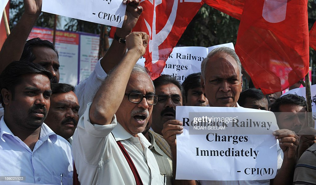 Activists of the Communist Party of India-Marxists(CPI-M) shout slogans against the United Progressive Alliance(UPA) during their protest against the rail fare hike, in Hyderabad on January 10, 2013. Union railways minister Pawan Kumar Bansal announced the fare hike to maintain safety and cleanliness with passenger fares hiked up from January 21. AFP PHOTO/Noah SEELAM