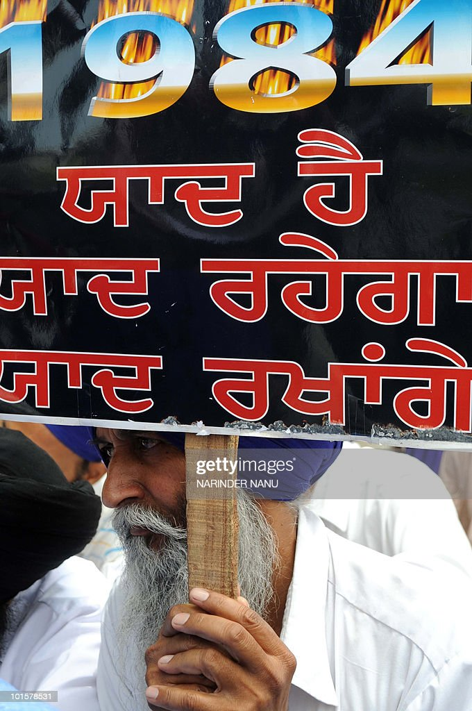 Activists of the Dal Khalsa radical Sikh organisation hold placards as they protest against the Indian government during a demonstration outside the Golden Temple in Amritsar on June 3, 2010, ahead of 'Ghallughara Diwas' the 26th anniversary of Operation Bluestar. On June 6, 1984, the deadly Operation Bluestar offensive by the national army countered Sikh separatists at the Golden Temple complex.