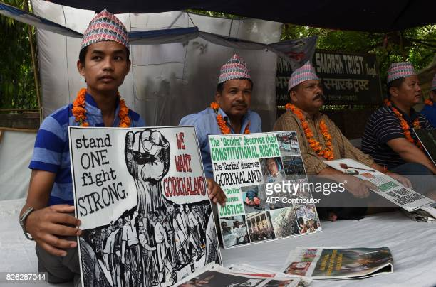 Activists of the Gorkhaland Movement Coordination Committee sit during a onehunger strike protest to demand a seperate state in New Delhi on August 4...