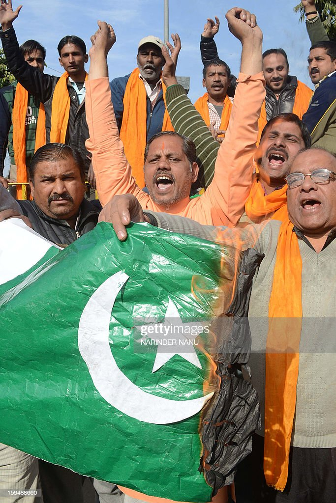 Activists of the Indian right-wing Hindu organisation Shiv Sena shout slogans as they burn the Pakistani national flag during a protest against the death of two Indian soldiers in the disputed Kashmir region, in Amritsar on January 14,2013. Indian and Pakistani commanders Monday traded protests over recent deadly exchanges in disputed Kashmir as the chief of staff in New Delhi ordered an 'aggressive' response to any fresh cross-border firing.