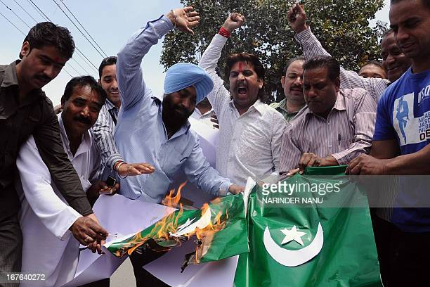 Activists of the Indian rightwing Hindu organisation Shiv Sena shout slogans as they burn a Pakistani flag during a demonstration in Amritsar on...