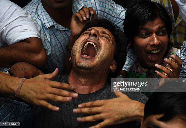 Activists of the Indian Youth Congress shout antigoverment slogans during a protest following a suspected militant attack in Punjab's Gurdaspur...