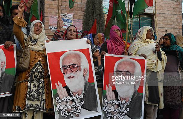 Activists of the Jamhoori Wattan Party protest as they hold banners featuring pictures of killed nationalist leader Nawab Akbar Bugti in Quetta on...