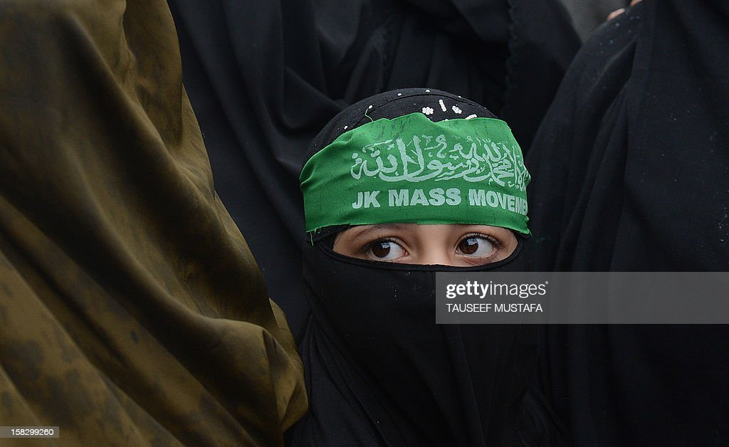 Activists of the Jammu and Kashmir Mass Movement (JKMM) participate during a protest in support of clemency for Mohammad Afzal Guru in Srinagar on December 13, 2012. Indian police detained some half a dozen activists during the protest. Fellow Kashmiri, Mohammad Afzal Guru was sentenced to death by an Indian court after being found guilty of being involved in the 13 September 2001 attack on India's Parliament House in New Delhi. The protestors appealed to the President to commute the death sentence of Guru and reinvestigate the case. AFP PHOTO/Tauseef MUSTAFA