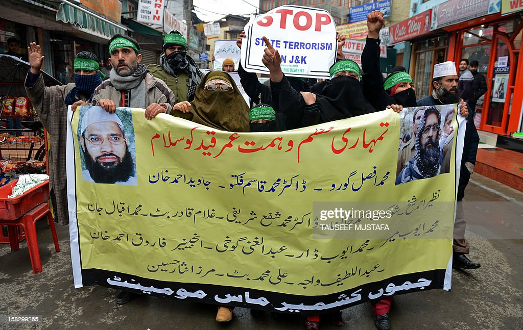 Activists of the Jammu and Kashmir Mass Movement (JKMM) shout anti_india slogans during a protest in support of clemency for Mohammad Afzal Guru in Srinagar on December 13, 2012. Indian police detained some half a dozen activists during the protest. Fellow Kashmiri, Mohammad Afzal Guru was sentenced to death by an Indian court after being found guilty of being involved in the 13 September 2001 attack on India's Parliament House in New Delhi. The protestors appealed to the President to commute the death sentence of Guru and reinvestigate the case. AFP PHOTO/Tauseef MUSTAFA