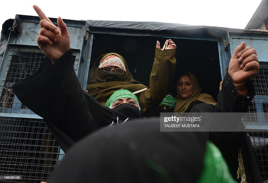 Activists of the Jammu and Kashmir Mass Movement (JKMM) shout slogans from a police van during a protest in support of clemency for Mohammad Afzal Guru in Srinagar on December 13, 2012. Indian police detained some half a dozen activists during the protest. Fellow Kashmiri, Mohammad Afzal Guru was sentenced to death by an Indian court after being found guilty of being involved in the 13 September 2001 attack on India's Parliament House in New Delhi. The protestors appealed to the President to commute the death sentence of Guru and reinvestigate the case. AFP PHOTO/Tauseef MUSTAFA