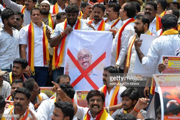 TOPSHOT Activists of the Karnataka Rakshana Vedike stage a protest against the statewide release of the upcoming 'Baahubali' film starring actor...