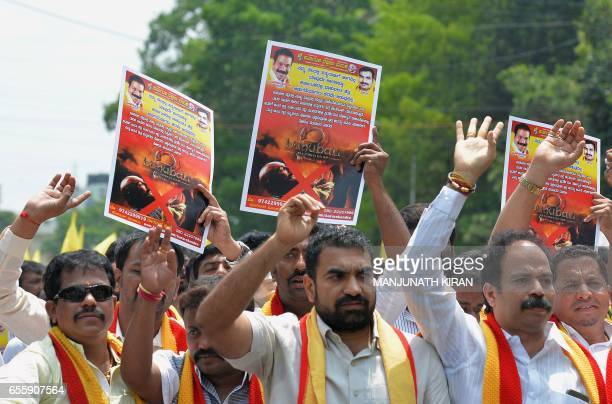 Activists of the Karnataka Rakshana Vedike stage a protest against the statewide release of the upcoming 'Baahubali' film starring actor Sathyaraj in...