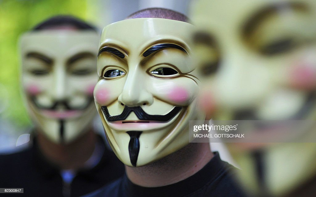 Activists of the organization 'Anonymous' hold masks in front of their faces on August 14 2008 during a demonstration in Berlin Members of...