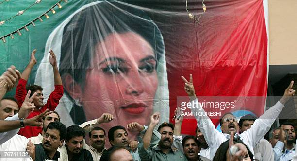Activists of The Pakistan People's Party celebrate after the announcement of the date of return to Pakistan of PPP chairperson and former Pakistani...