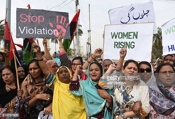 Activists of The Pakistan People's Party hold placards as they march during a rally to mark International Women's Day in Karachi on March 8 2016...