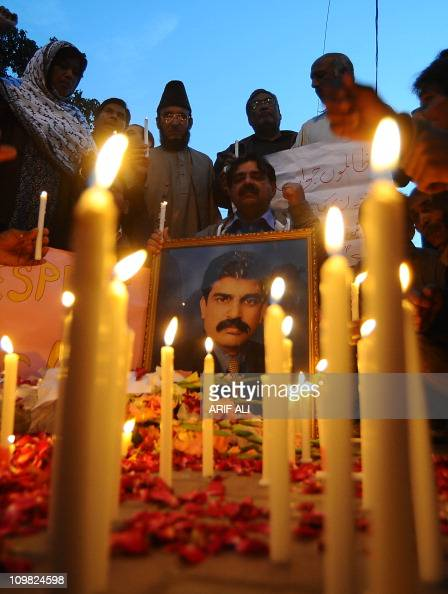 Activists of the ruling Pakistan Peoples party light candels in front of the picture of slain minority affairs minister Shahbaz Bhatti in Lahore on...