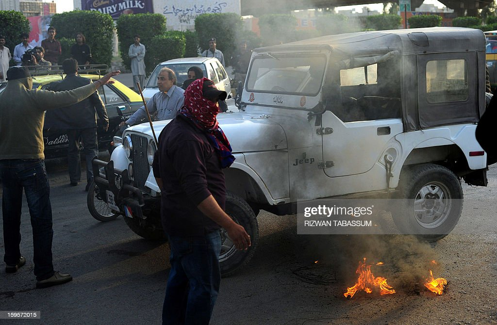 Activists of the ruling Pakistani Peoples Party (PPP) burn tyres as they protest against the Supreme Court decision to arrest Pakistan Prime Minister Raja Pervez Ashraf, at a rally in Karachi on January 16, 2013. Pakistan's top judge Tuesday ordered the arrest of the prime minister over graft allegations, threatening to worsen turmoil as thousands of protesters demanded parliament be dissolved. AFP PHOTO/Rizwan TABASSUM