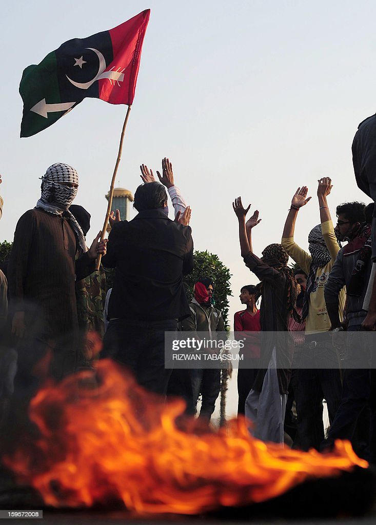 Activists of the ruling Pakistani Peoples Party (PPP) burn tyres during a protest against the Supreme Court decision to arrest Pakistan Prime Minister Raja Pervez Ashraf, at a rally in Karachi on January 16, 2013. Pakistan's top judge Tuesday ordered the arrest of the prime minister over graft allegations, threatening to worsen turmoil as thousands of protesters demanded parliament be dissolved. AFP PHOTO/Rizwan TABASSUM
