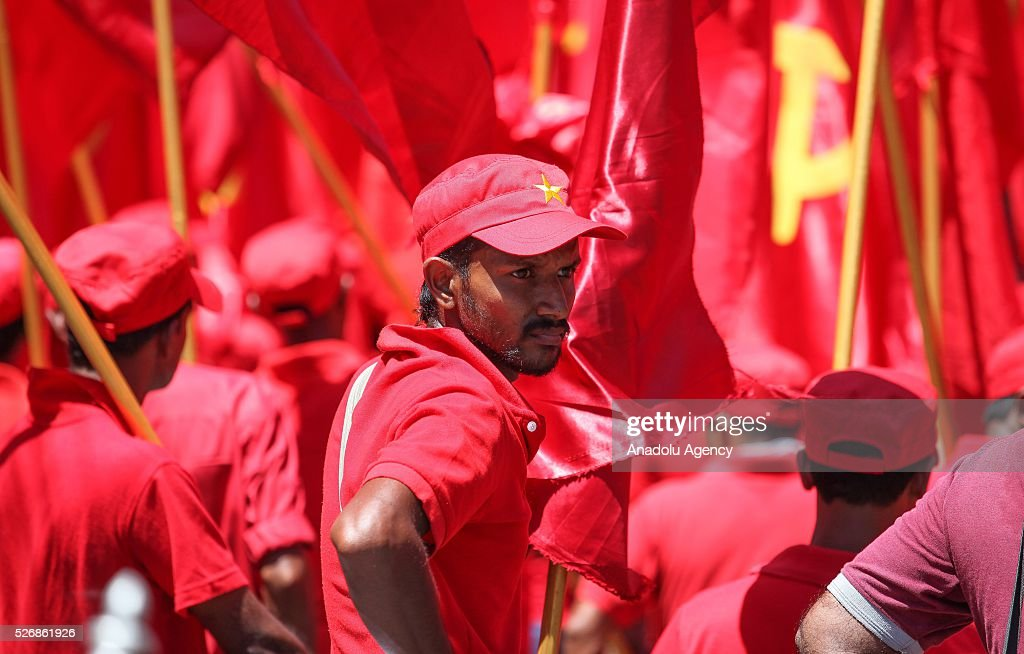 Activists of the Sri Lankan Marxist political party Peoples' Liberation Front march during a rally to mark International Labor Day in Colombo, Sri Lanka, on May 1, 2016.