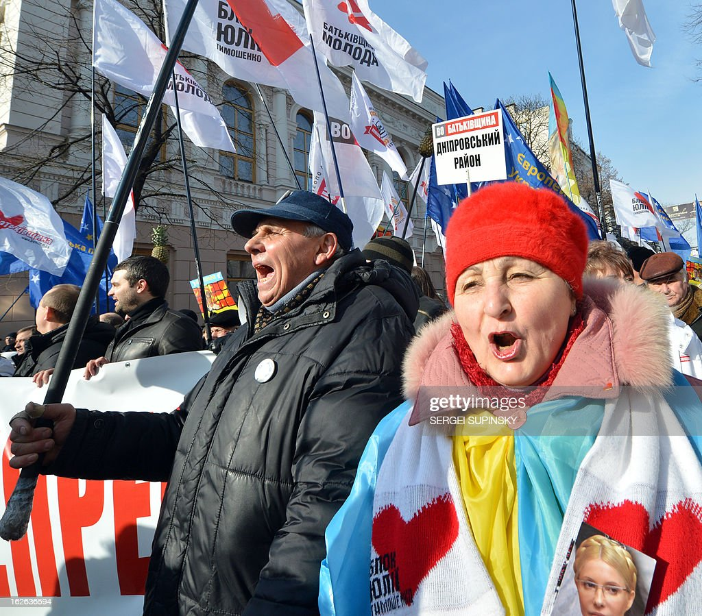 Activists of the Ukrainian opposition shout anti-president Yanukovych slogans during a march and rally called by 'Kievites against political repression!' in Kiev on February 25, 2012. Ukraine President Viktor Yanukovych flies in to Brussels for a summit today seen as 'a defining moment' in a long-delayed bid to seal a political and trade pact with the EU anchoring the ex-Soviet state closer to the West.
