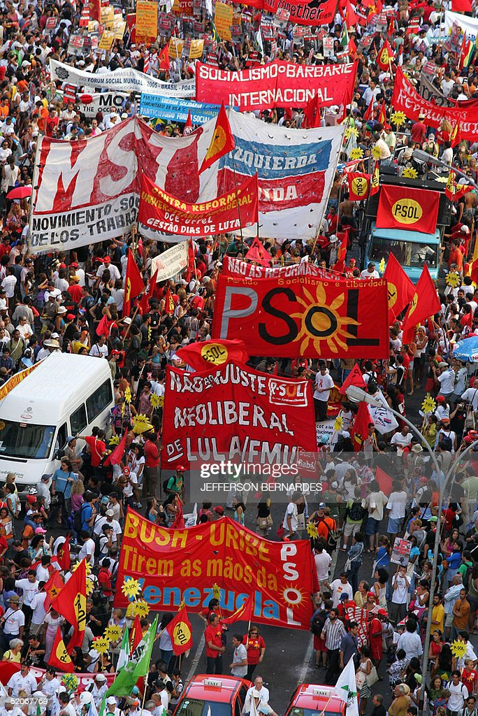 Activists of the V World Social Forum take part in the opening march 26 January 2005 in Porto Alegre Tens of thousands of antiglobalization militants...