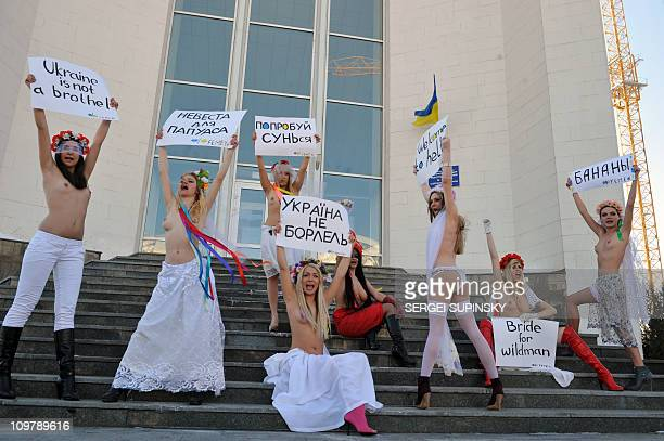 Activists of Ukrainian feministic movement FEMEN shout slogans and hold placards reading 'Ukraine is not a bordello' 'Welcome to hell' 'Bride for...
