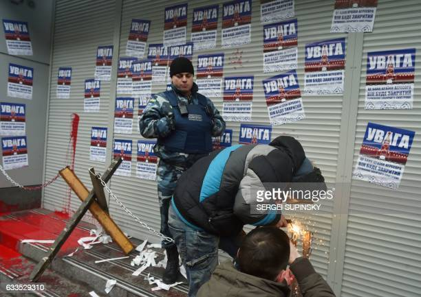 Activists of Ukrainian radical party 'National Corps' weld symbolic chain and antitank constractions at the entrance of a local branch of the Russian...