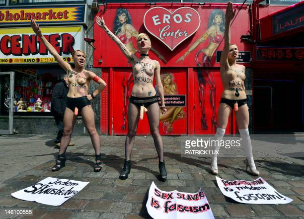 Activists of Ukraninan feminist group FEMEN demonstrate in front of a brothel in the red light district Reeperbahn in Hamburg on June 10 2012 The...