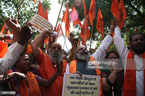 Activists of United Hindu Front raising slogan during a protest against 'Love Jihad' at New Delhi Love Jihad is an alleged activity under which young...