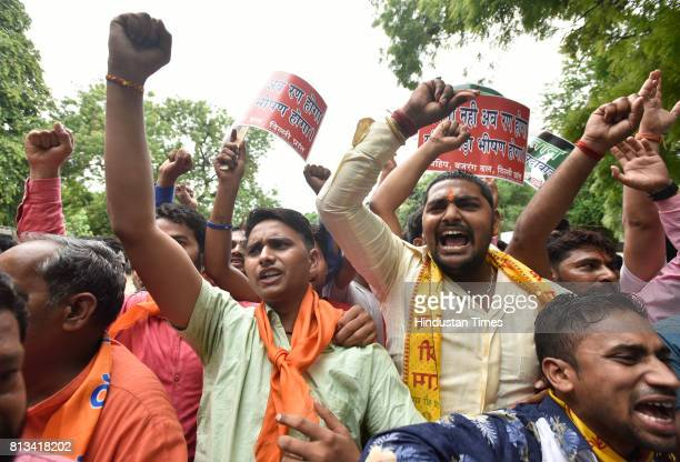 Activists of Vishva Hindu Parishad and Bajrang Dal shout slogans during a protest against the killing of seven Hindu pilgrims during the Amarnath...