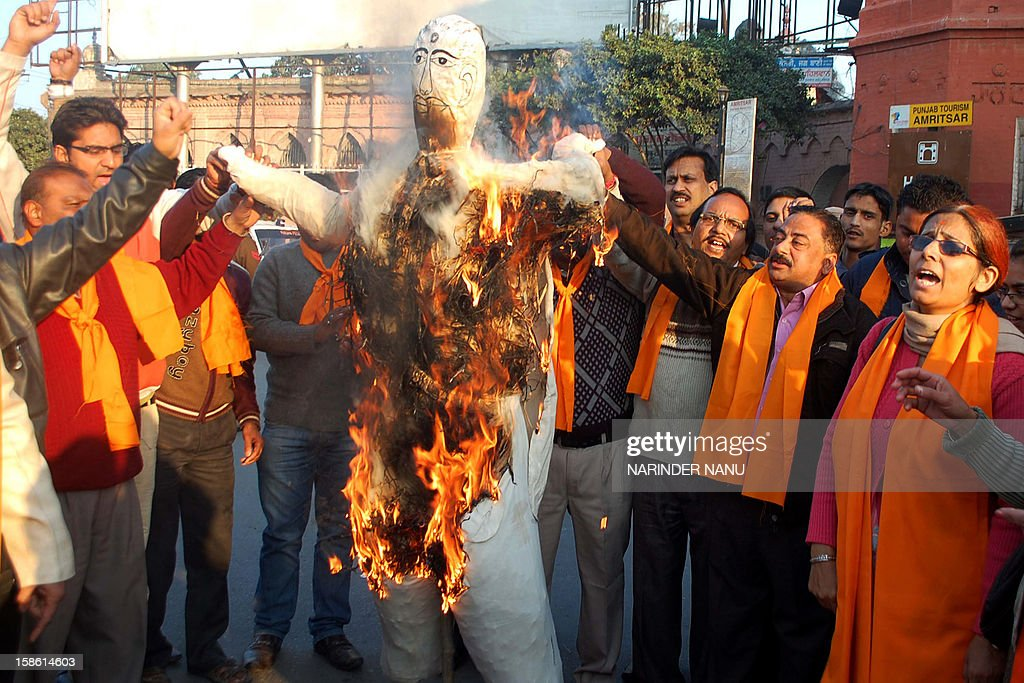 Activists of Vishva Hindu Parishad (VHP) and The Durga Vahini (Army of Durga) shout slogans as they burn an effigy of Delhi Chief Minister Sheila Dikshit during a protest in Amritsar on December 21, 2012, following the gang-rape of a student in the Indian capital. Indian police have arrested the driver and four others of a bus after a student was gang-raped and thrown out of the vehicle, reports said, in an attack that has sparked fresh concern for women's safety in New Delhi. The attack sparked new calls for greater security for women in New Delhi, which registered 568 rapes in 2011 compared with 218 in India's financial capital Mumbai the same year.