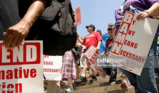 Activists organized by BAMN march to the US Supreme Court May 15 2004 in Washington DC to mark the anniversary of the Brown vs Board of Education...