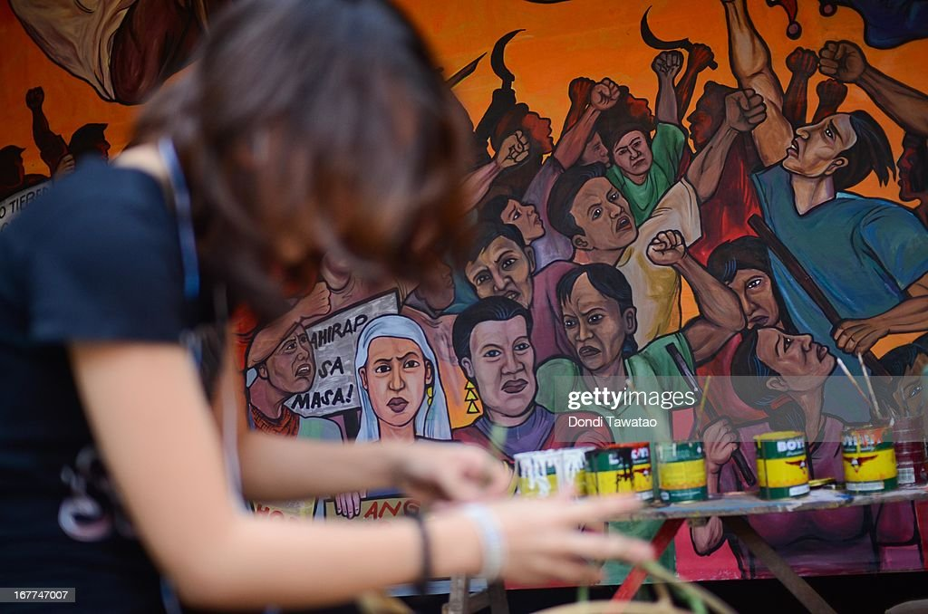 Activists paint a mural of workers and peasants that will be used for the coming labor day protest rallies on April 29, 2013 in Quezon City, Philippines. Militant labor groups and trade unions are gearing up for protest rallies in front of the presidential palace on May 1 Labor Day citing the president's refusal to sign into law a wage increase which would benefit 8 million underemployed Filipinos. Despite the high poverty incidence remaining unchanged for the past six years The Philippines posted a healthy GDP growth, but government statistics show that the benefits of economic growth have yet to reach the poor.