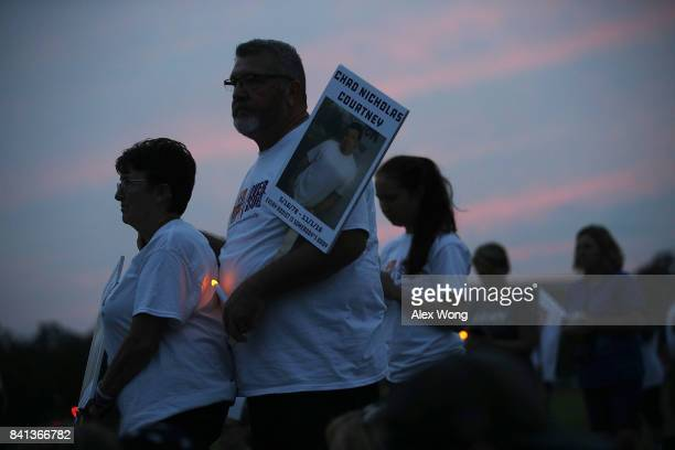 Activists participate in a candlelight vigil at the Ellipse August 31 2017 in Washington DC FED UP Coalition hosted its annual International Overdose...