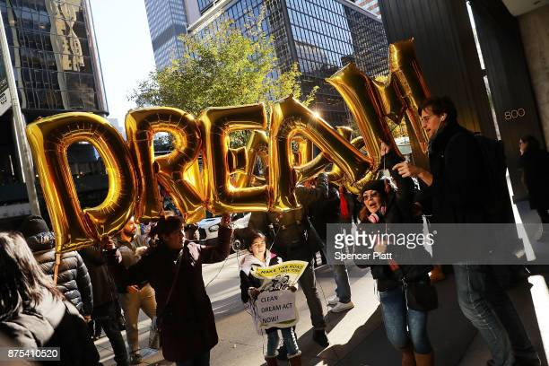 Activists participate in a march and rally outside of three financial companies following a report by the Center for Popular Democracy describing...