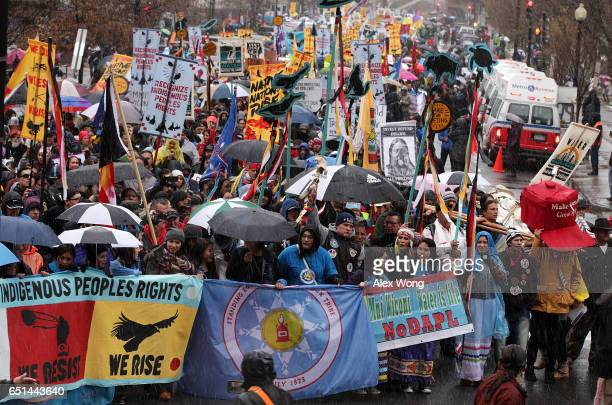 Activists participate in a protest against the Dakota Access Pipeline March 10 2017 in Washington DC The Standing Rock Sioux Tribe held the event...