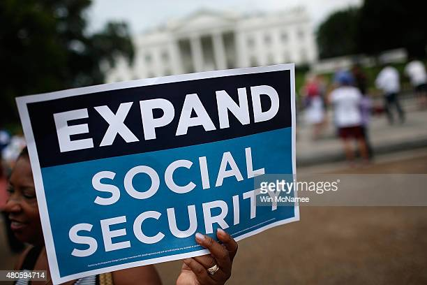Activists participate in a rally urging the expansion of Social Security benefits in front of the White House July 13 2015 in Washington DC Social...
